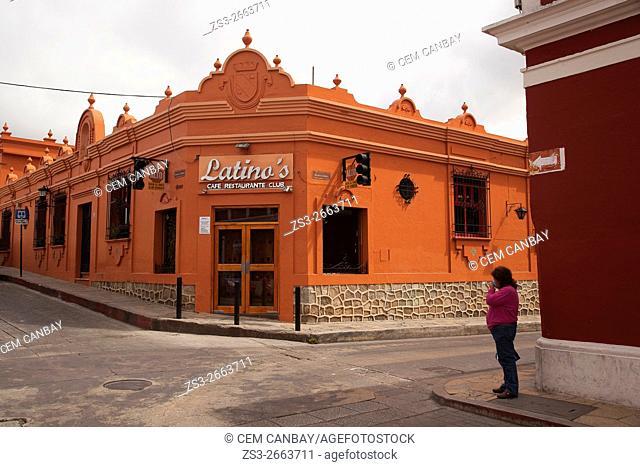 Woman in front of a restaurant in town center, San Cristobal de las Casas, Chiapas Province, Mexico, Central America