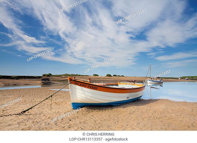 England, Norfolk, Burnham Overy. A boat moored on Burnham Overy Staithe