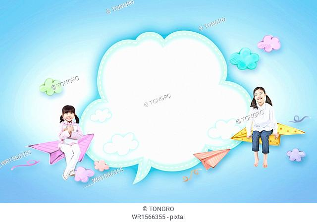 two girls sitting on paper planes