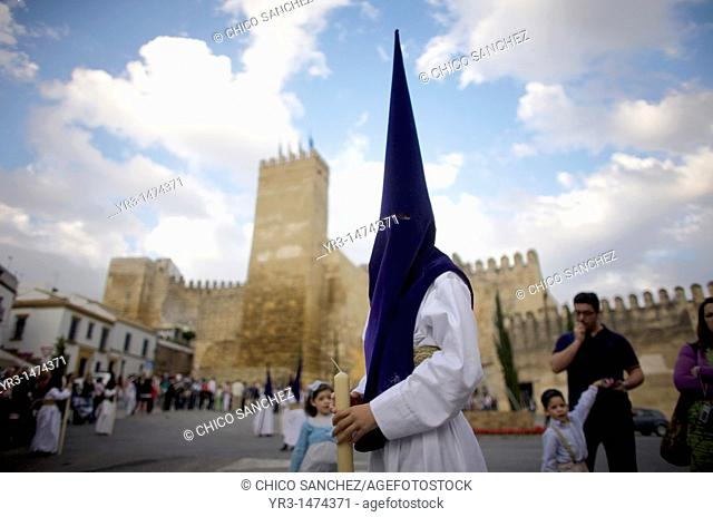 A penitent participates in an Easter Holy Week procession in front of the Alcazar fortress in Carmona, Seville province, Andalusia, Spain, April 19, 2011