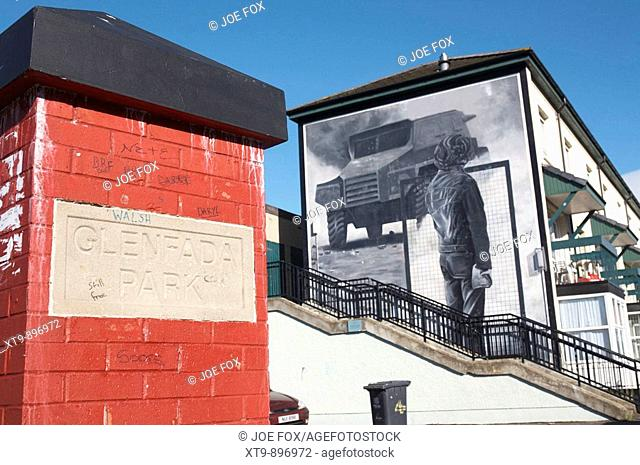 Entrance to Glenfada Park and The Saturday Matinee ( The Rioter ) mural as part of the peoples gallery murals in Rossville Street of the bogside area of Derry...