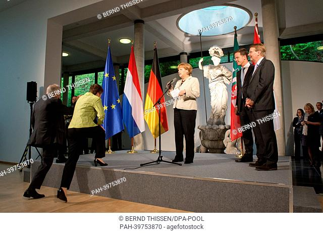 German Chancellor Angela Merkel talks during a reception for first German-DutchCabinet Meeting while with Mayor of Kleve Theodor Brauer (L) escorts...
