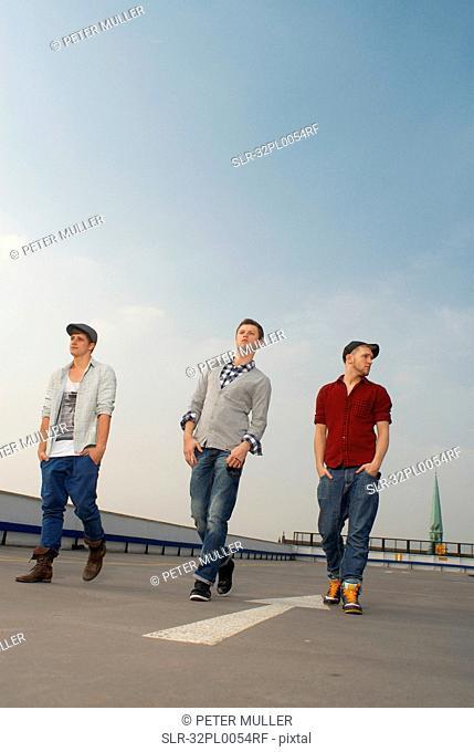 Men walking together on rooftop
