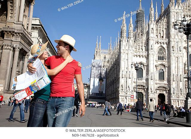 Young couple with city map in milan