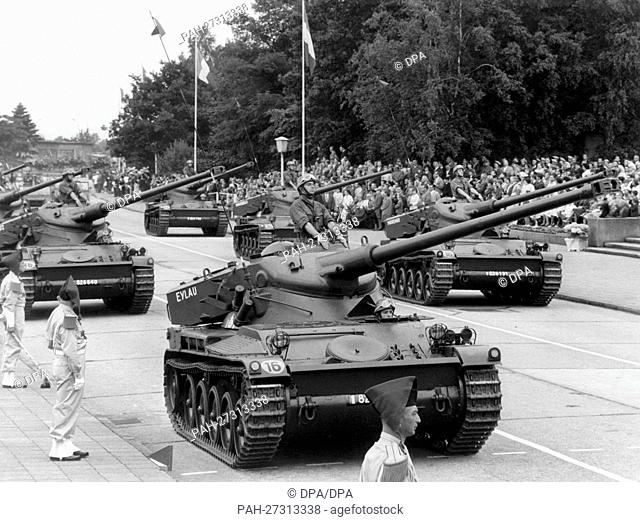 Tanks drive past the honorary tribune during the parade on the occasion of the French national day on the 14th of July in 1962 in the headquarters Quartier...