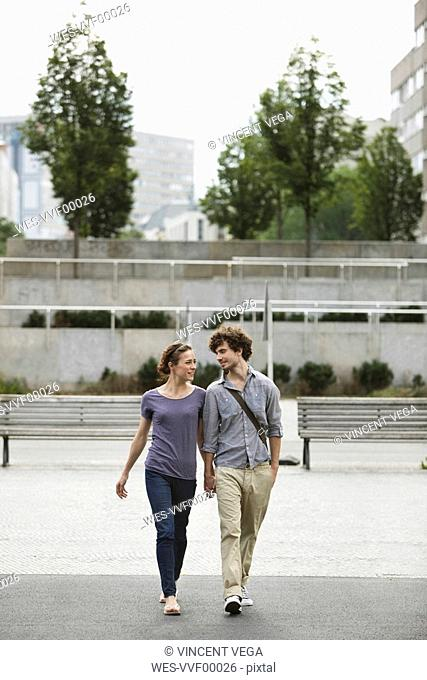 Germany, Berlin, Young couple holding hands