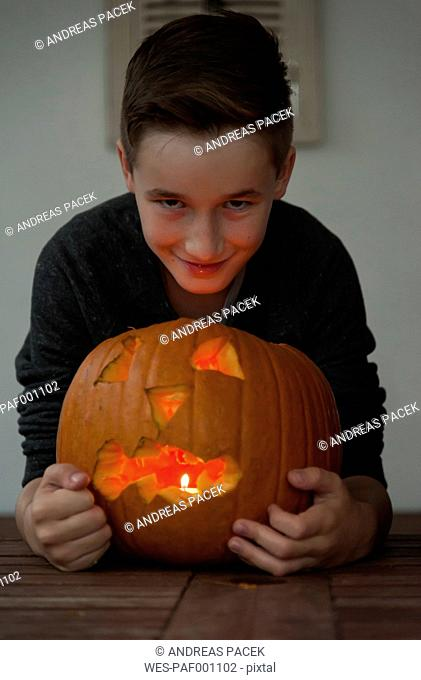 Portrait of boy with Jack O'Lantern