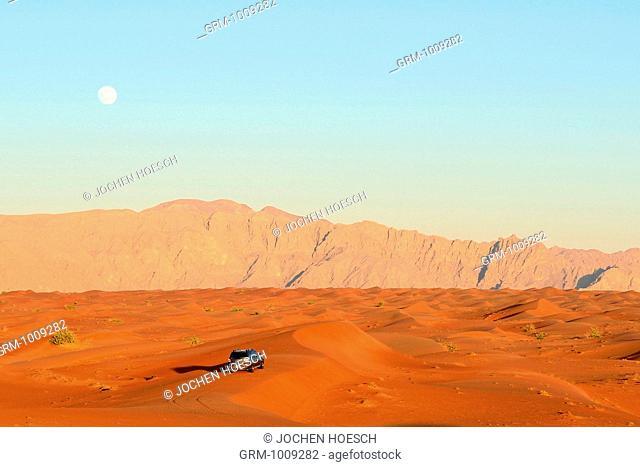 4x4 car driving through desert near Al Ain, United Arab Emirates