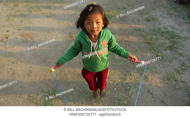Kathmandu Nepal child plays with jump rope at chilrens home in Eastern Kathmandu, Nepal