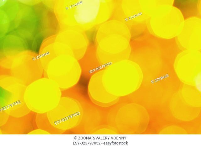 blurred yellow green big Christmas lights