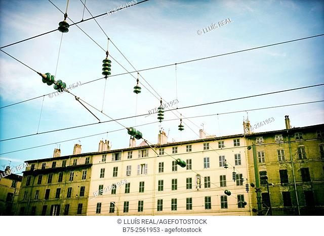 Forefront of the electrical wires With the blue sky of the railway station of Toulon, and in the background a residential building