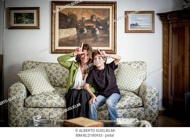 Caucasian grandmother and grandson gesturing loser