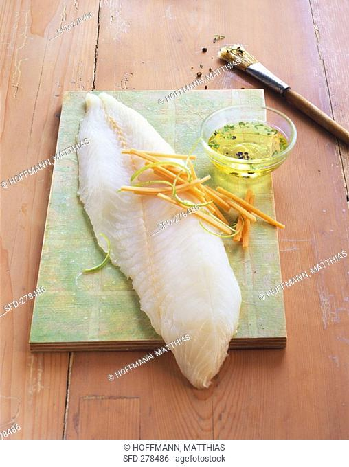 Hake fillet with julienne vegetables and marinade