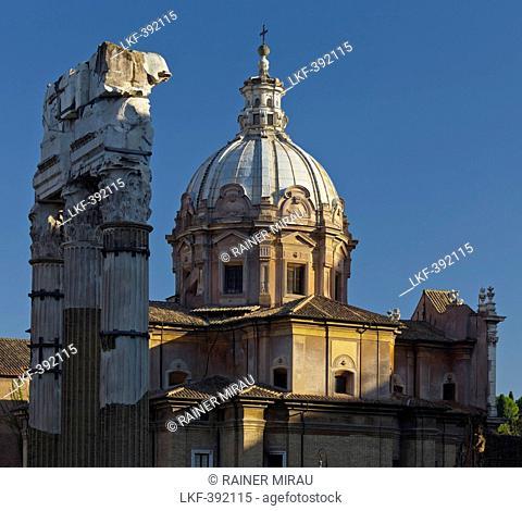 Forum of Caesar, Foro di Cesare, Forum Romanum with Corinthian columns, Santi Luca e Martina church in the background, Rom, Lazio, Italien