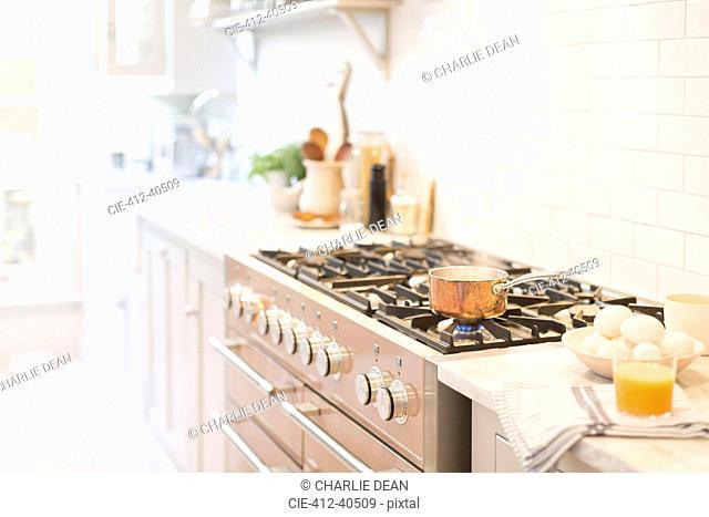 Copper pot on kitchen stove