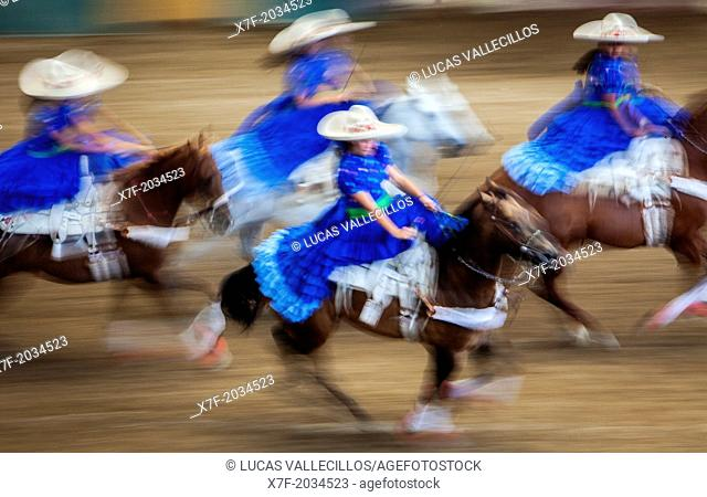 Escaramuzas ride their horses. A charreada Mexican rodeo at the Lienzo Charro Zermeno, Guadalajara, Jalisco, Mexico