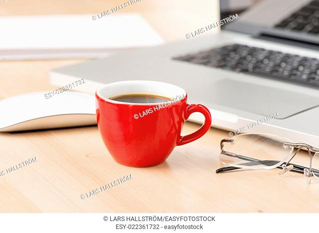 Office equipment at workplace. Desktop with laptop. Conceptual image of desk work, communication technology and business