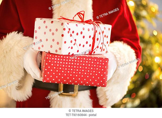 Santa claus holding presents