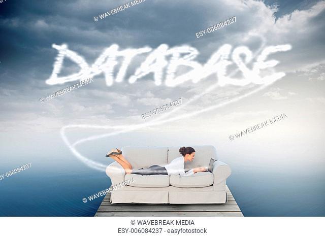 Database against cloudy sky over ocean