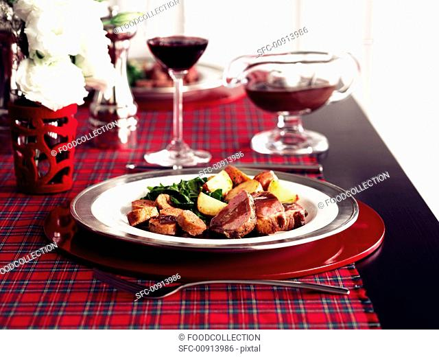 Veal with potatoes and gravy
