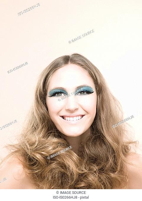 A young woman wearing false eyelashes