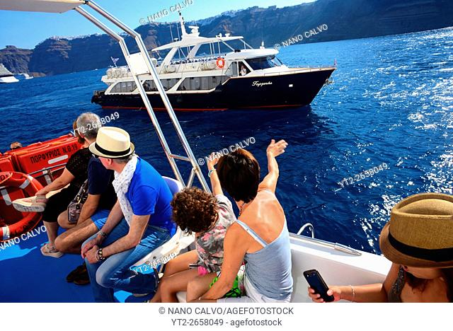 Boat that carries tourists from cruise ship to Fira, Santorini, Greek Islands, Greece