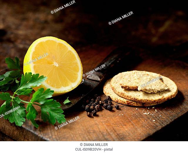 Oat biscuits, peppercorns, half a lemon and coriander