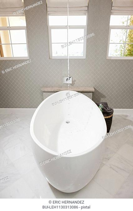 White free standing bathtub in contemporary bathroom