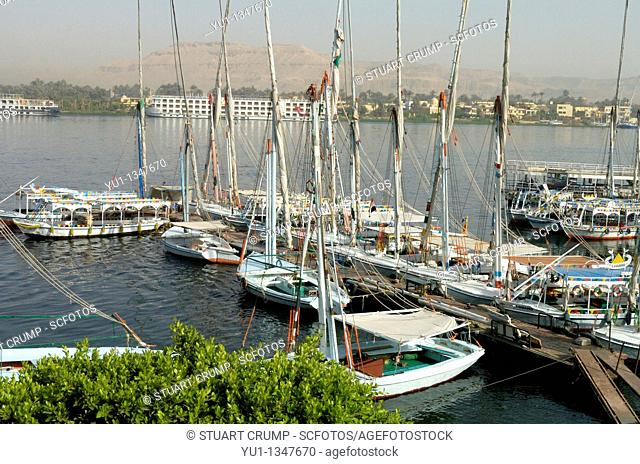 Feluccas & Sail Boats at the Quayside on the River Nile alongside the Corniche in Luxor, Egypt, North Africa