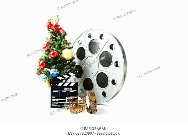 Christmas tree with red gold and blue balls, cinema big reel and movie clapperboard on white background