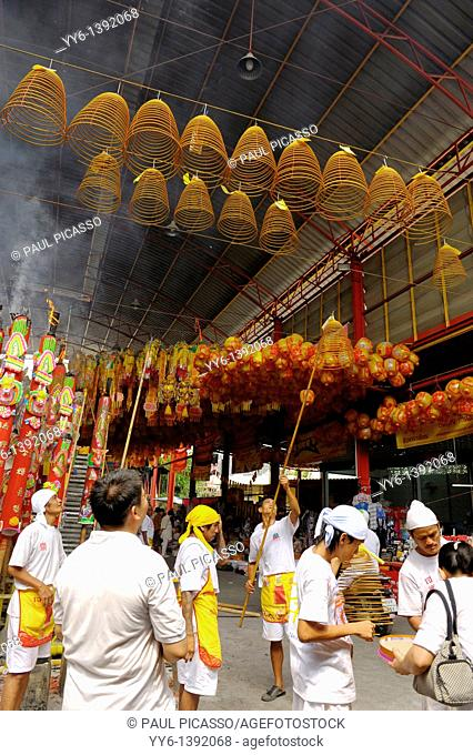 Devotees hang incense swirls and ceremonial lanterns high among the rafters ,Vegetarian festival at San Jao Sieng Kong shrine , wat sung heng yee, Chinatown