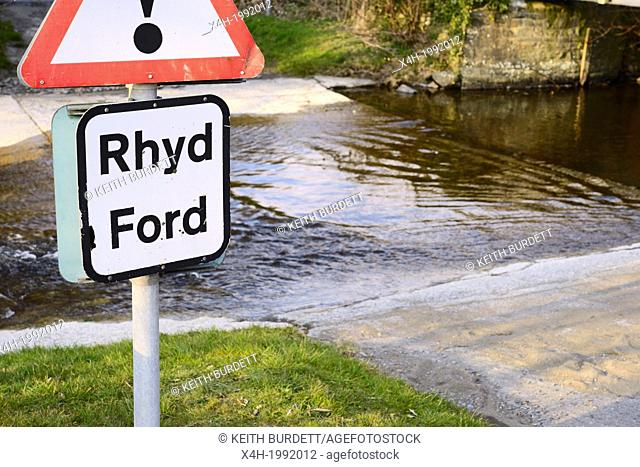 Bilingual sign in Welsh and English warning of a river crossing or ford, Llanrhystud, Wales, UK