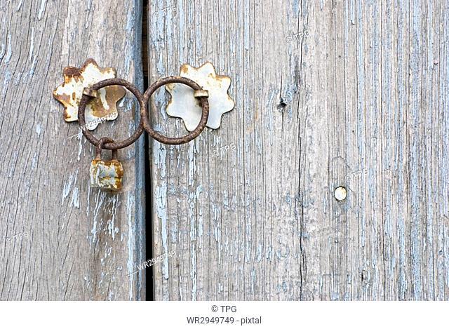 Old chinese doorknocker and wooden textured door