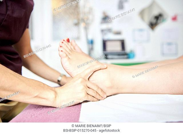 Reportage in a physiotherapy practice in Lyon, France. A physiotherapy session on a foot that was damaged a long time ago, but which is painful again