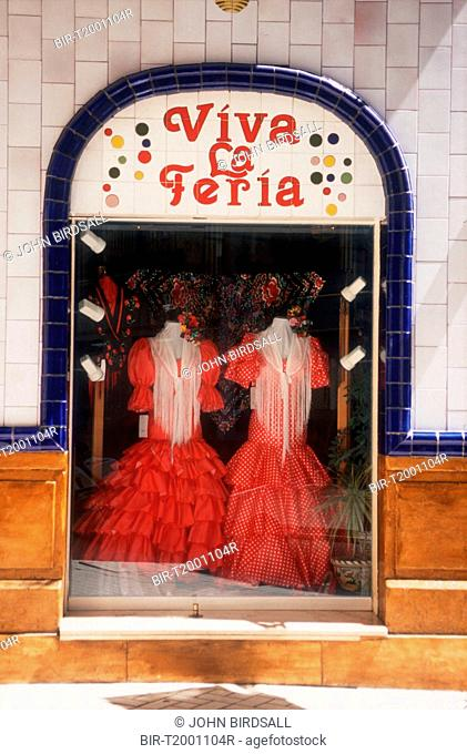 Viva La Feria Flamenco dresses displayed in shop window, Malaga