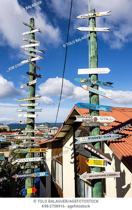 Chile, Patagonia, Punta Arenas (Sandy Point), Cerro de la Cruz, Various directional signs on tall post