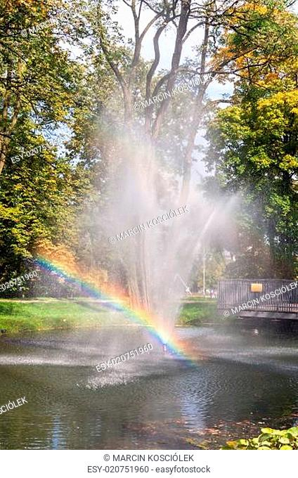 Fountain with rainbow in the park of Czestochowa