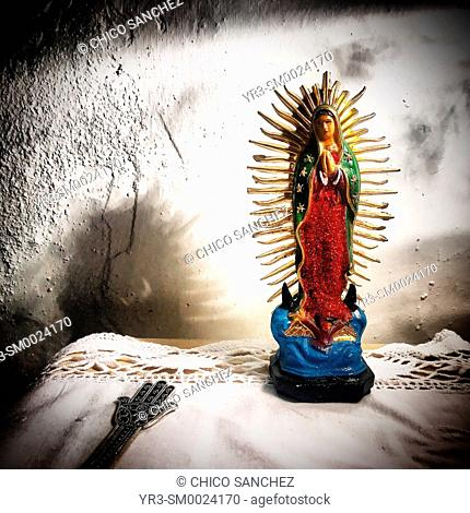 An image of Our Lady of Guadalupe and the Hand of Our Lady of Fatima decorate a home in Prado del Rey, Sierra de Cadiz, Andalusia, Spain