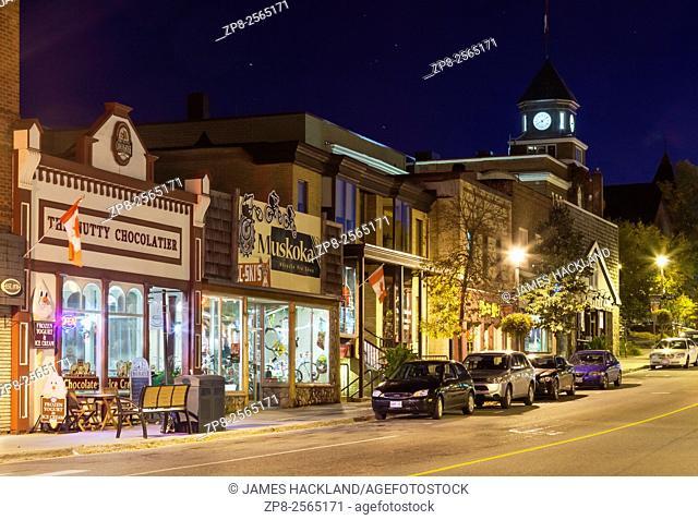 Storefronts along Main Street in downtown historic Huntsville at Dusk. Huntsville, Muskoka, Ontario, Canada
