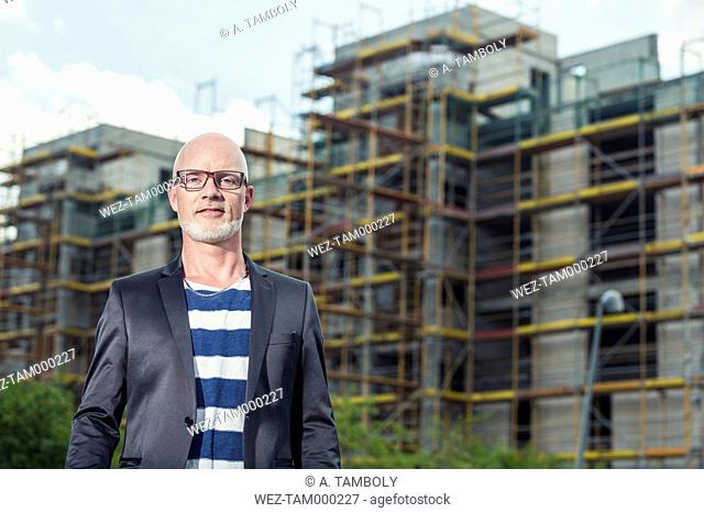 Portrait of a man standing in front of construction site