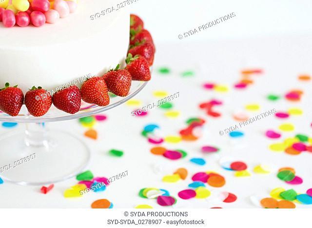 close up of birthday cake with strawberries