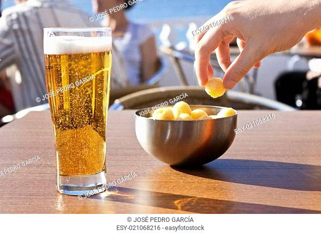 Eating snacks with beer