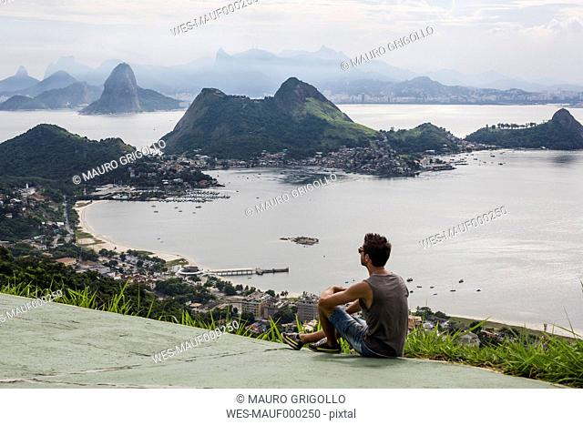 Brazil, Rio de Janeiro, tourist sitting at view point