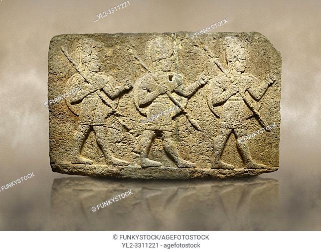 Photo of Hittite monumental relief sculpted orthostat stone panel of Herald's Wall Basalt, Karkamıs, (Kargamıs), Carchemish (Karkemish), 900-700 B