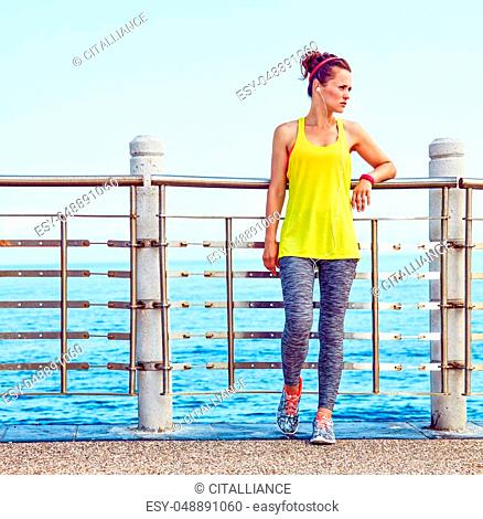 Look Good, Feel great! Full length portrait of young woman in fitness outfit looking aside at the embankment