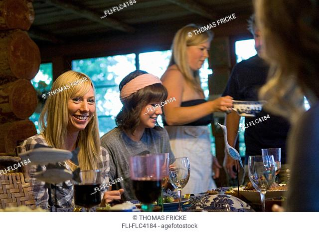 Guests sitting at a cabin dinner table