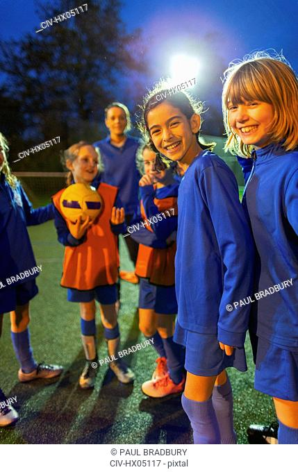 Portrait smiling, confident girls soccer team
