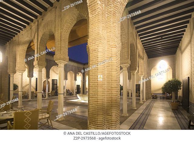 State run hotel Parador in Carmona, Seville province, Spain on October 8, 2017. Illuminated courtyard