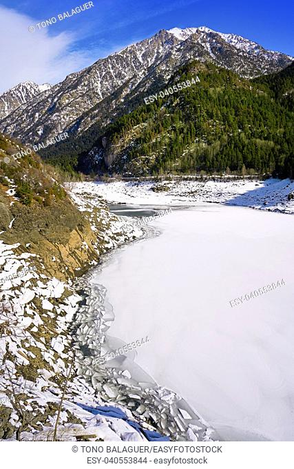Benasque frozen reservoir Paso Nuevo in Pyrenees of Spain