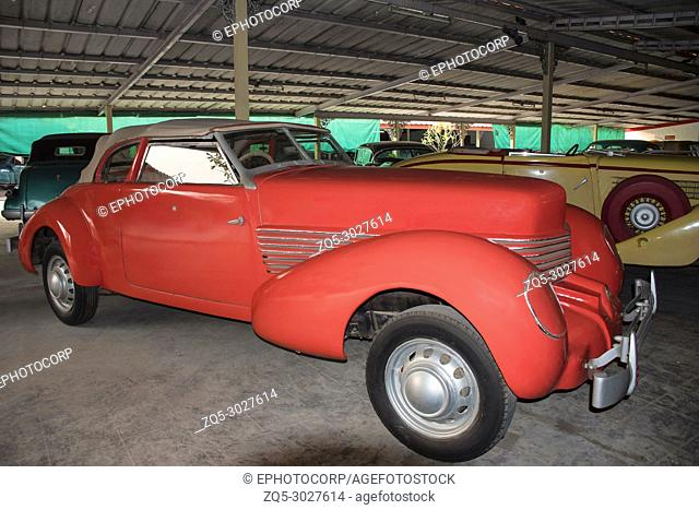 Coral colored antique car in Auto World Vintage Car Museum of Ahmedabad Gujarat